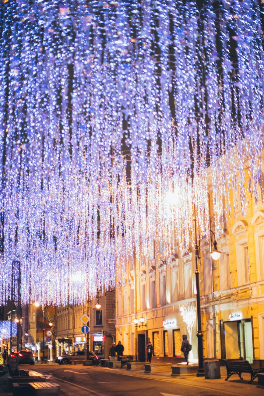 christmas illumination on city street in evening
