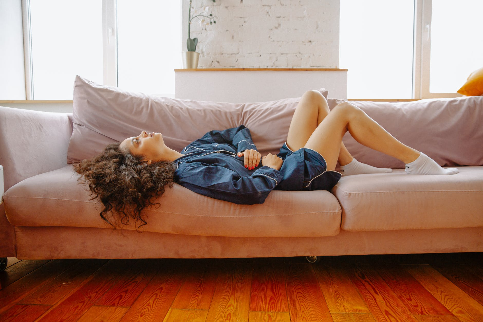 woman lying on couch