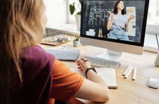 photo of girl watching through imac