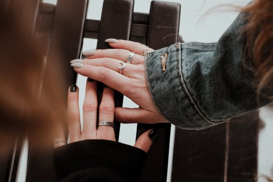 women fingers with rings
